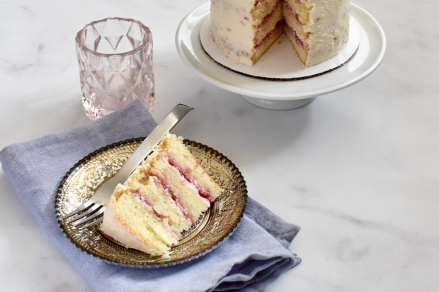 Slice of layered strawberry mini cake on a plate.