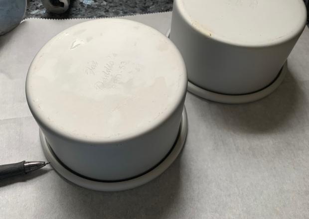 Two mini cake pans on parchment.